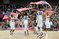 United States teammates (from left) Chris Paul, James Harden, Anthony Davis and Russell Westbrook celebrate winning the men's basketball gold medal game against Spain.