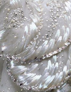 """Detail of the embroidery on the """"Venus"""" dress, feather-shaped opalescent sequins, rhinestones, simulated pearls and paillettes"""