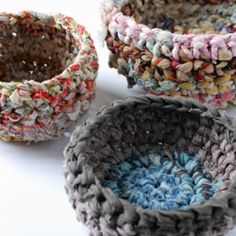Use fabric scraps to make fabulous storage baskets. Tutorial shows how to make fabric yarn and rag rope.