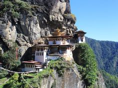 Bhutan — If you're a couple that seeks adventure, head to the Himalayas to hike the hills of Bhutan. Explore the outdoors while mountain biking, rock climbing, river rafting, and fishing, and take in Bhutan's scenic views of valleys and temples hidden within.