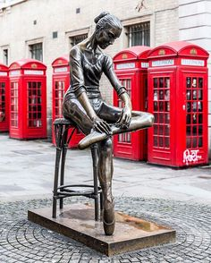 Ballerina sculpture and red phone boxes in Covent Garden, London