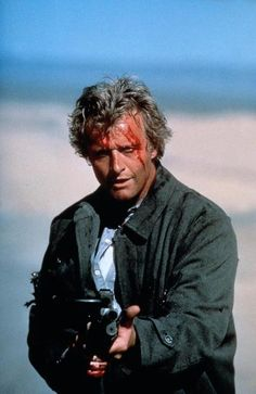 "P Rutger Hauer. While most people instantly think of his classic ""tears in rain"" speech from the magnificent Blade Runner, i always remember him in The Hitcher and Flesh & Blood. He had a unique charisma on screen and I grew up loving his movies. 80s Movies, Film Movie, Horror Movies, King Kong, The Hitcher, Rutger Hauer, Tv Icon, Natural Born Killers, Flesh And Blood"
