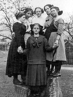 high school girls posing tree stump 19111912 black white 1910s archive boot bow children circle girl people teenager vertical vintage youth