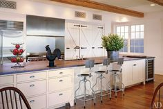 Decorator Karin Blake brought New England style to a home in Malibu, California. The large cabinet doors, featuring strap hinges and rat-tail pulls, are copies of ones Blake salvaged from a barn owned by the late actor George Montgomery.