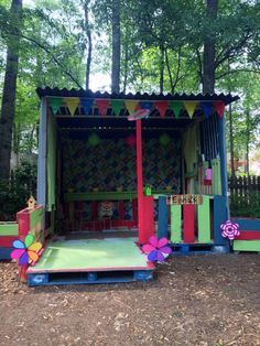 Our playhouse made from pallets, 2x4s and roofing material.