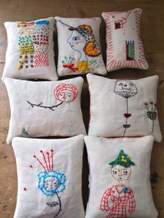 Jess Quinn: embroidered lavender pillows.