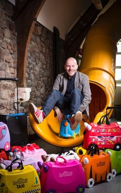 The inventor of the Trunki suitcase Rob Law, photographed at his company HQ in Bristol surrounded by Trunki and new Jurni suitcases. The Inventors, Photographer Pictures, Suitcases, Sign Design, Bristol, Bean Bag Chair, Law, March, Children