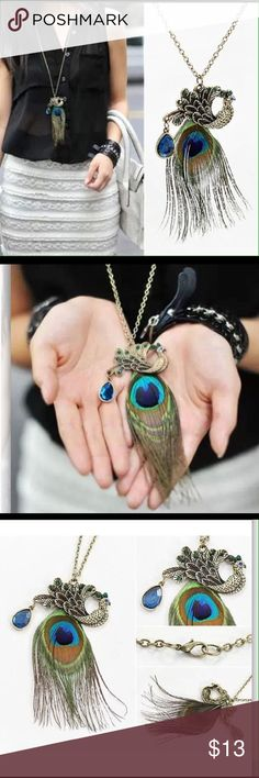 """Peacock feather necklace 32"""" Antique bronze chain.  Colorful peacock charm and feather tail.  From charm to bottom of feather is 2.5-3"""" long.  Light blue and green stones on peacock charm. Jewelry Necklaces"""