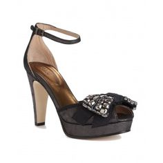 Sandal  by See by Chloé  Black metallic sandal with stone bow on toe and ankle strap.