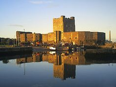 Carrickfergus Castle, County Antrim, reflections at sunset.A few miles from Belfast. Haunted? Of course.