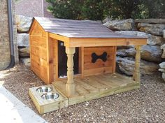 Dog house with feeders