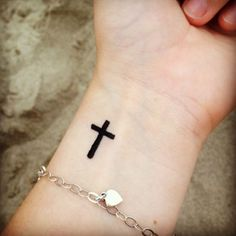 Cute simple cross wrist tattoo. So want this but I'm too undecided about religion so wouldn't feel quite right.