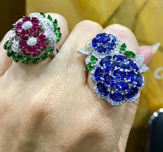 Handcrafted ruby and sapphire rings embellished with diamonds and tsavorites by Magia. Gems Jewelry, High Jewelry, Photo Jewelry, Jewelry Art, Jewlery, Jewelry Design, Stylish Rings, Rings Cool, Faberge Eier
