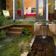 Water features in a backyard are always wonderful as long as they are kept moving and aren't a breeding ground for bugs.