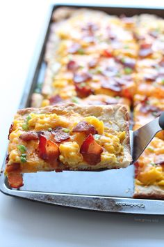The perfect breakfast pizza topped with soft scrambled eggs, crispy bacon, and lots of melted cheddar cheese!!