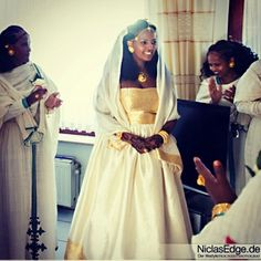Habesha bride in her zuria/habeshakemis, adorned in werk/werki.