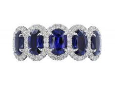 18 Karat White Gold Custom Made Band Consisting Of 5 Oval Sapphires Having A Total Weight Of 2.59 Carats. The Sapphires Are Surrounded By A Total Of 80 Round Brilliant Cut Diamonds Having A Total Weight Of .67 Carats.