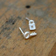 Sterling silver lock and key earrings.