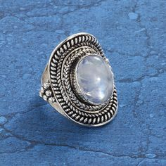 P41879 5 -     Moon Goddess Ring  Exclusive! Selena. Gemstone of the lunar goddess, this generously sized, shimmering cabochon of genuine rainbow moonstone glows in its elaborately braided setting of silver over brass. Whole sizes 5-11.  ****  Item #: P41879  Price: $49.95