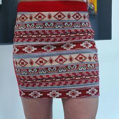 """💋 Aztec print skirt NWOT Brand new no tags Front of skirt features a fabulous threaded Aztec print while the backside is solid red. Pair with a white top and heels!  Size small Zips up on side Material 76%polyester 20%rayon, 4%spandex Length approx 15"""" Dani Collection Multi colored   *price is firm unless bundle (5%off bundles of 3 or more) *No trades Skirts Mini"""