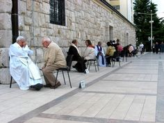 Confessions at St. James, Medjugorje (the largest confessional in the world)