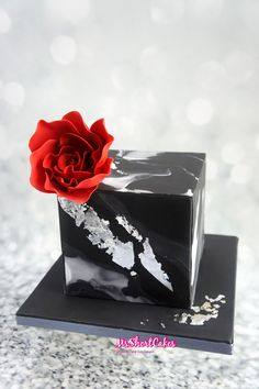 A Black Marbled birthday cake with silver leaf