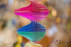 Multi colored spiral made from small wooden sticks