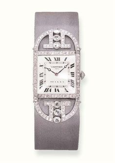 AN ELEGANT ART DECO DIAMOND WRISTWATCH, BY CARTIER   With 14 jewelled lever movement, adjusted to eight positions, matte silvered guilloché dial with Roman numerals and blued steeled moon hands, rectangular case with rose-cut diamond bezel and winding crown, to the rose-cut diamond shoulders of geometric design and grey silk strap with rose-cut diamond bar clasp (moon hands of later addition), circa 1911, 16.5 cm  Dial, movement and strap signed Cartier, case numbered 10777 1900, stamped…