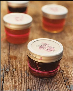 wedding favor idea: instead of table place card, write the number and the name of each guest on the lid and arrange the jars (like you would do the place cards) so each guest picks their jar and takes it to their table.