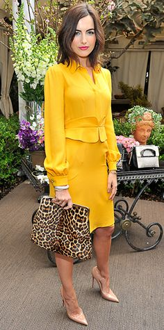 """Camillia Belle lit up the Christian Louboutin celebration of the """"Passage"""" handbag collection in a goldenrod yellow Gucci shirtdress with a matching belt, nude Louboutin pumps, while aptly carrying an oversize leopard-print Louboutin bag."""