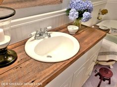 Hate your countertops?  DIY salvaged wood counter...cheap and so much more awesome than tile (for me at least) ;)
