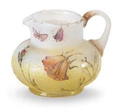 A MINIATURE ETCHED AND ENAMELED GLASS PITCHER,