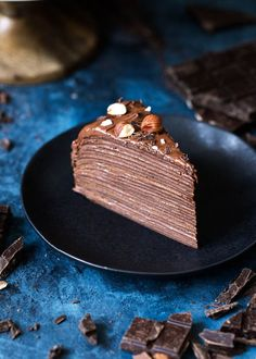 This week the /kingarthurflour/ Holiday Table features this knock-out Chocolate Hazelnut Crêpe Cake from Broma Bakery. Chocolate Crepes, Decadent Chocolate, Chocolate Desserts, Crepe Cake Chocolate, Chocolate Hazelnut Pastry, Chocolate Pinata, Hazelnut Cake, Mint Chocolate, Bonbon