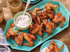 Bobby douses these grilled chicken wings in a smoky chipotle sauce that's made with Dijon mustard, chipotle puree and ancho chile powder. The cool blue cheese-yogurt dip is perfect for cutting the intense smokiness.