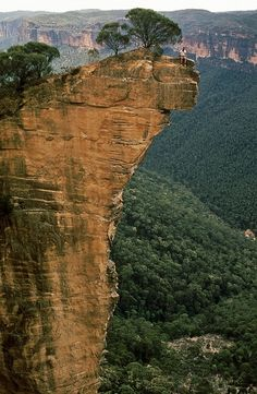 South Africa. Someone sitting on the edge of a cliff. Crazy guy must of never been in an earthquake.