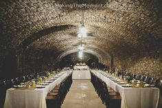 Reception table set up in a wine cellar  http://www.makingthemoment.com/blog/2012/a-mon-ami-winery-wedding