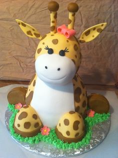 3D giraffe cake with matching smash cake for a little girls first birthday. When they requested a giraffe cake i immediately wanted to try a 3D cake. with a little inspiration from some wonderful cakes here i made this. I couldnt be more pleased with how she turned out and the customers loved it too! body and feet are wondermold pans/mini wondermold pans. head is rkt.