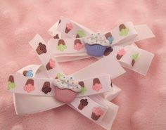 Pair of Hair Bows- white and cupcake. $8.00, via Etsy. Use coupon code 'summer12' at check out & get 10% off