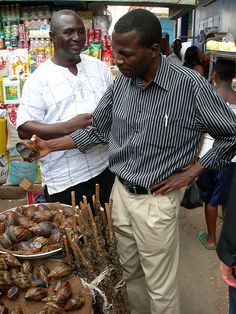 Makola Market, Accra, Ghana with some very large snails by michaelseangallagher, via Flickr