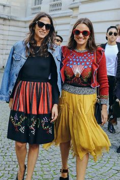 Capucine Safyurtlu and Laure Hériard-Dubreuil in a Valentino sweater spotted on the street at Paris Fashion Week. Photographed by Phil Oh.