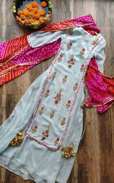 Buy Powder Blue Embroidered Dress Online – LabelKanupriya designs indian style Powder Blue Embroidered Dress You are in the right place about slimming clothes for women Here we offer you the mos Designer Kurtis, Indian Designer Suits, Indian Designer Clothes, Punjabi Suits Designer Boutique, Indian Gowns, Indian Attire, Indian Dresses For Women, Indian Dresses Online, Indian Wedding Outfits