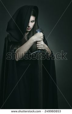 Evil expression of beautiful dark woman with  sword . Fantasy and legend