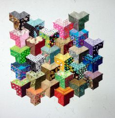 On the design wall:  inner city tumbling blocks from a class by Joanne Farmery at Quilters Lane (New Zealand)