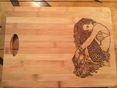 A personal favorite from my Etsy shop https://www.etsy.com/listing/252533081/large-cutting-board-wood-burned-with-a