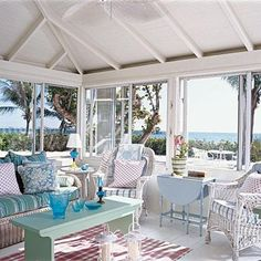 love the white wicker with the aqua colors for beach cottage