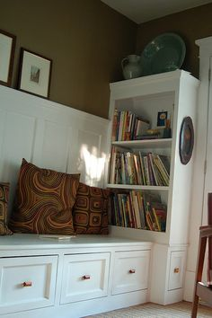 Wrap around built-in bookshelf. I like the height. White looks beautiful against that wall color.