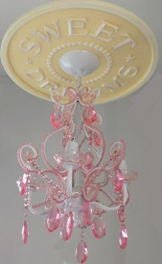 Sweet Dreams Ceiling Medallion in yellow distressed by Marie Ricci. 4 arm pink chandelier and medallion available at www.mariericci.com
