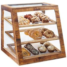 """Showcase all of your tempting muffins, cookies, and treats in a stylish way with this Cal-Mil 3432-S-99 Madera reclaimed wood 3 tier slanted bakery display case! This display case includes (3) 13"""" x 18"""" clear trays that are removable for easy cleaning. The self serve style doors allow your guests to choose their favorite snack and serve themselves. <br><br> Perfect for your coffee shop, bakery or cafe, this three-tier case utilizes vertical space and presents your foods ..."""