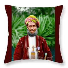 African Official Throw Pillow by Jan Brons  Found this image as a damaged and scratched black and white photograph. Have spent hours repairing the photo and got carried away as I decided that it would look marvelous as colorized image. Spent way too much time on this image but loved my waste of time.  I just loved the pride this man showed in his beautiful costume, red green turban, sword, medallion, grey beard and mustache. Also the contrast between red dress and green foliage in the…