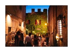 An oldie but goodie: Certaldo Alto, in Tuscany, in the magic lights of its most important festival, Mercantia, taking place each second week of July in the medieval town. Red bricks, Tuscany and street art. What could be more fun? #certaldo #tuscany #mercantia #streetart www.hotelcertaldo.it